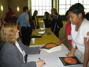 Noreen signs book copies