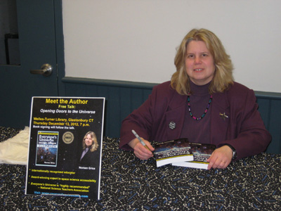 Noreen signing copies of her book